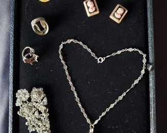 Cameo brooches and vintage locket necklace. https://ctbids.com/#!/description/share/171881