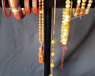 Coral colored bracelets and necklaces https://ctbids.com/#!/description/share/171886