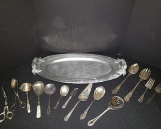 Silver goldfish tray and silverplated serving accessories. https://ctbids.com/#!/description/share/171959