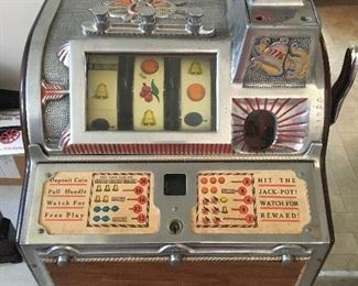 FULL SHOT OF MILLS NICKEL SLOT VENDING MACHINE