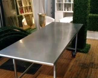 Stainless-steel rolling table.