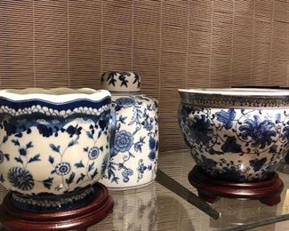 Blue and white cachepots, ginger jars and fish bowls in a variety of styles, shapes and large quantities.