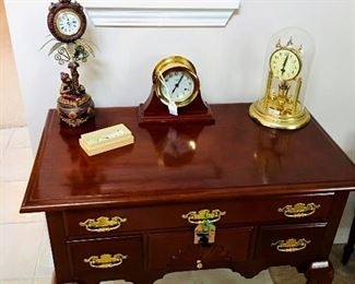 Bombay Co Entry Table; Capodimonte Porcelain Flowers; Assorted Table Clocks