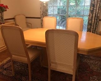 Dining table with inside leaves and 6 chairs - has a matching buffet