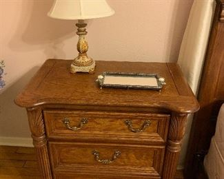 Wooden night stand with three drawers