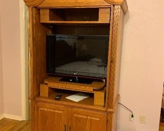 Wooden armpit with flat screen tv