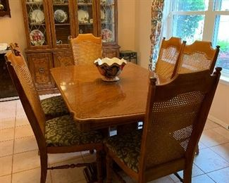 Burled wood trimmed pecan dining table with 6 chairs and 1 leaf. Excellent condition.