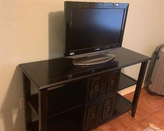 "Tv console and Sharp 24"" flat screen tv"