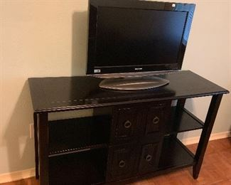Lovely tv console and several flat screen TVs for sake