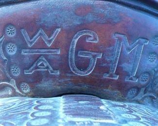 Carved brand on saddle