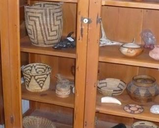 Native American Pottery and Baskets.   Glass door Display Cabinet.