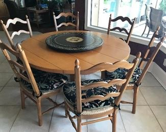 "DREXEL HERITAGE 56"" ROUND WOOD TABLE W/ 6 RUSH SEAT LADDER BACK CHAIRS, LAZY SUSAN IS IN CENTER OF TABLE"