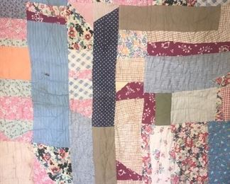 Antique quilt made of feed sacks Hand sewn
