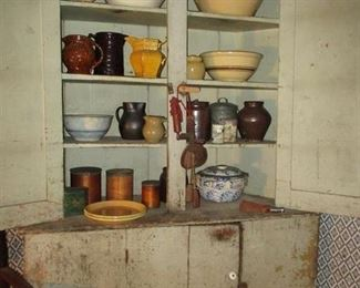 country pieces in cupboard