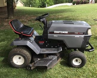 Side view of the Craftsman Mower that is in good condition, and waiting to be a part of your Father's Day Celebration.