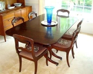 Duncan Phyfe dining table with pads and 3 leaves,  and six Victorian chairs.