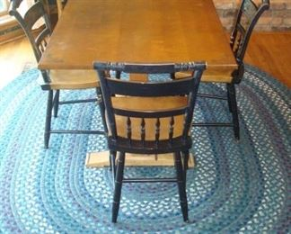 Stenciled Hitchcock trestle table and four signed Hitchcock chairs. Oval braided rug.