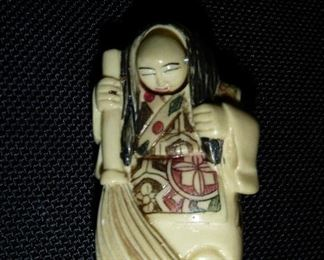 lovely antique Netsuke with rotating face, signed