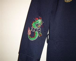 """details of embroidery on his """"Korean drinking suit"""""""