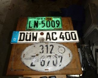 several vintage European car tags, the green one is a NATO tag