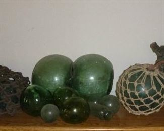 """Vintage Japanese glass fishing net floats, including hard to find binary glass float, some have Maker's Marks. The largest one measures 37"""" in diameter."""