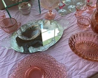Over 125 pieces of pink depression glass.