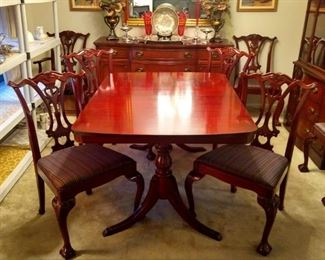 1940's mahogany dining table, Hampton Court, by Drexel. There's also a matching buffet and china cabinet. The eight chairs are Henredon; there are two arms and six sides