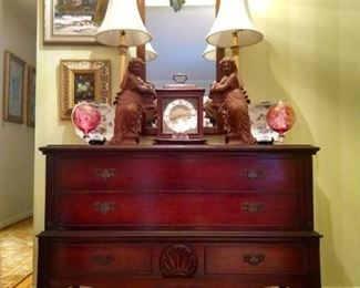 Wonderful 1940's mahogany blanket chest, by local Chattanooga legend, Cavalier, pair of handcarved wooden maidens (as opposed to iron maidens) pair of brass candlestick table lamps, Seth Thomas 8-day chiming clock. all atop a yummy Persian Heriz runner.