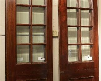 Two Mahogany Beveled Glass Panel Doors
