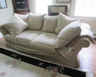 Large over stuffed ivory damask sofa