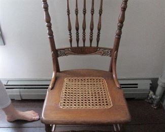 One of two (a pair) Victorian nicely carved chairs with cane seats in great condition