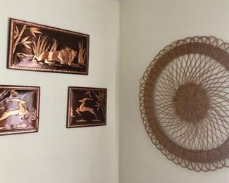 Embossed framed copper pictures & wicker wall art.