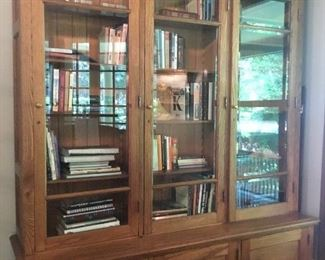 Beautiful solid oak bookcase. 4 shelves and 3 bottom shelves for great storage. $1400