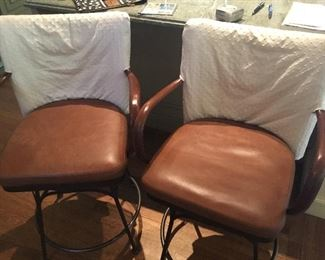 2 leather barstool iron base with wicker backs needing repair $60 each