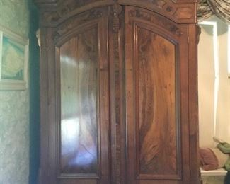 Stunning pristine armoire with 3 large shelves and 2 drawers.