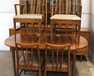 Mid Century Modern 8 Piece Danish Walnut Dining Room Set with 2 Piece China and 2 Leaves  Auction Estimate $500-$1000 – Located Inside