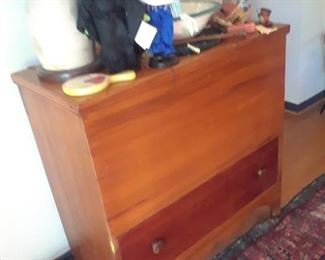 Unusual blanket chest utilizing two types of wood on the front of the chest