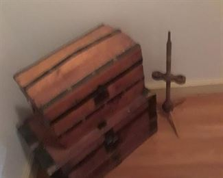 Doll trunk on top of larger trunk, both with metal strapping