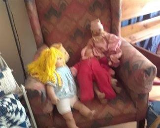 Upholstered chair andvintage handmade dolls