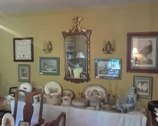 Ornate mirror, wood with gilded embellishment, many sets of game plates, turkey platters, and more