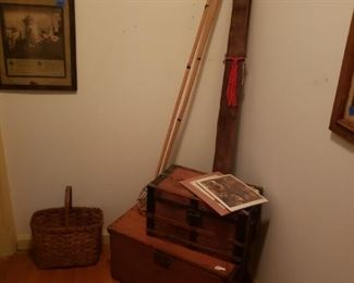 Wood ski poles, old trunks, basket