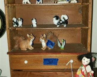 Vintage porcelain animals. Japanese doll, display shelf