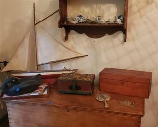 Antique blanket chest, old boxes, display shelf with doll teasets and other collectibles