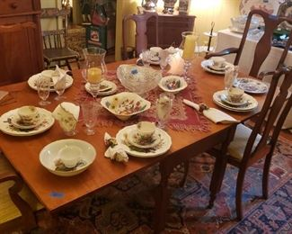 Cherry dining table, Queen Anne chairs; copeland Spode dinnerware in Reynolds pattern