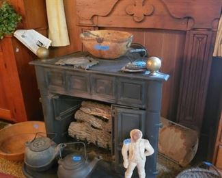 Mantle, gas stove, cast iron kettles. Door stop, baskets