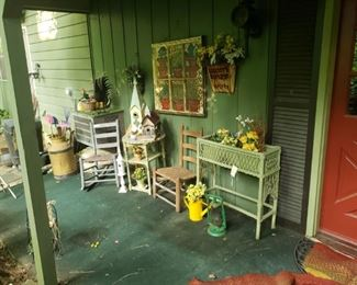 Lots of great porch decor, including bird houses, watering cans, yard art. baskets, painted windows and more