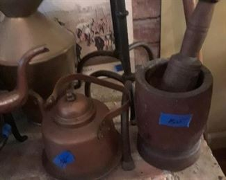 Copper kettles, wood mortar and pestle