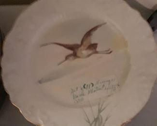 Set of 11 Limoges bird plates