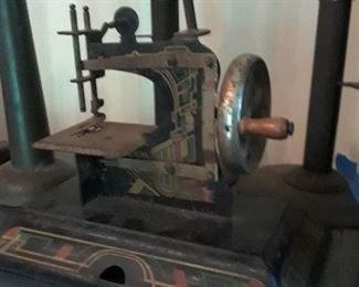 Antique sewing machine, child's