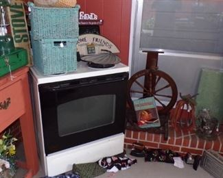 Stove, lots of misc., rolled up Rug - in the Patio Room